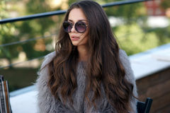 Trendy girl in fur coat Royalty Free Stock Images
