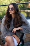 Trendy girl in fur coat Stock Photo