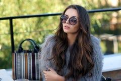 Trendy girl in fur coat Royalty Free Stock Photos