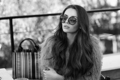 Trendy girl in fur coat Stock Photo