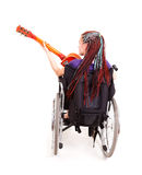 Trendy girl with guitar on the wheelchair Royalty Free Stock Photos