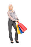Trendy girl holding shopping bags Royalty Free Stock Photo