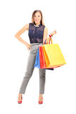 Trendy girl holding shopping bags Stock Photo