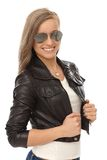 Trendy girl in leather jacket and sunglasses Stock Photos