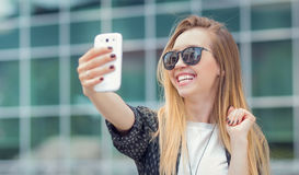 Trendy girl make a selfie Stock Images