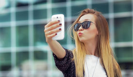 Trendy girl make a selfie Stock Photo