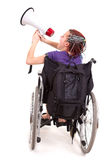 Trendy girl with megaphone on the wheelchair Stock Images