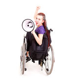 Trendy girl with megaphone on the wheelchair Stock Photo