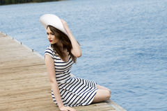 Trendy girl near blue sea Royalty Free Stock Image
