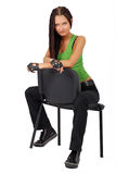 Trendy girl sat on chair Royalty Free Stock Photo