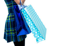 Trendy girl with shopping bags, cropped image Stock Photos