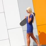 Trendy girl with skateboard Stock Photos