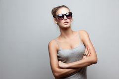 Trendy girl in sunglasses stock photography