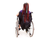 Trendy girl on the wheelchair Royalty Free Stock Photography