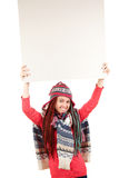 Trendy girl in winter hat with blank sign Stock Image