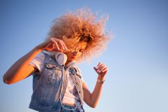 Trendy Girl With Large Headphones On Sky Background, Free Space On The Right. Stock Photos