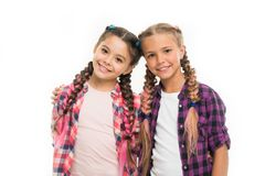 Trendy girls. Dress similar with best friend. Dress to match your friend. Best friend dressing. Friends wear similar. Outfits have same hairstyle braids white royalty free stock images