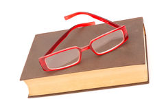 Trendy glasses on old book Stock Photography