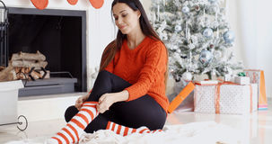 Trendy gorgeous young woman relaxing at Xmas Stock Images