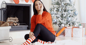 Trendy gorgeous young woman relaxing at Xmas Royalty Free Stock Photos