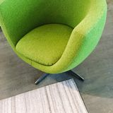 Trendy green armchair. On dark wooden floor. Modern furniture Stock Photography