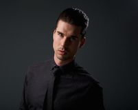Trendy guy in black shirt and tie Stock Photography