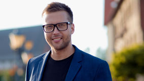 Trendy guy with glasses in the street. Portrait on the background of the city. Trendy guy with glasses in the street Royalty Free Stock Photography