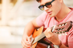 Trendy guy with guitar outdoor Royalty Free Stock Images