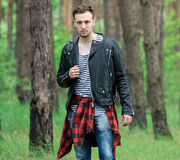 Trendy guy in the pine forest Stock Images