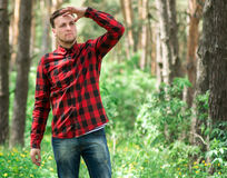 Trendy guy in the pine forest Royalty Free Stock Photo
