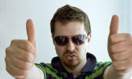 Trendy guy showing ok sign Royalty Free Stock Image
