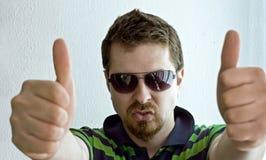 Trendy guy showing ok sign. Portrait of trendy guy showing ok sign Royalty Free Stock Image