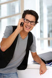 Trendy guy with smartphone Royalty Free Stock Photos