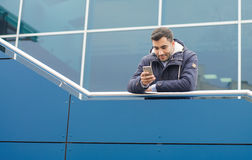 Trendy guy with smartphone Royalty Free Stock Image