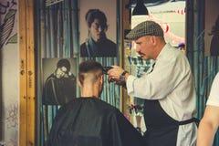 Trendy hair cut at the barber salon stock photos