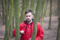 Trendy handsome man posing in spring park alone.  Royalty Free Stock Images