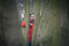 Trendy handsome man posing in spring park alone.  Royalty Free Stock Photo