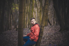 Trendy handsome man posing in spring park alone.  Stock Photography