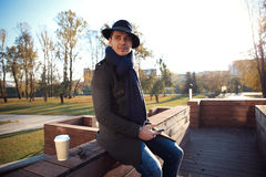 Trendy handsome young man in autumn fashion standing in urban environment. Royalty Free Stock Photography