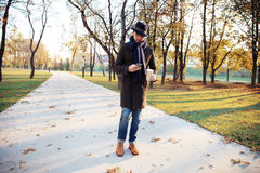 Trendy handsome young man in autumn fashion standing in urban environment. Stock Image