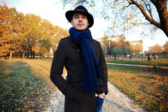 Trendy handsome young man in autumn fashion standing in urban environment. Royalty Free Stock Photos