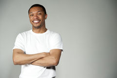 Trendy Happy and Fun Black Male Wearing A White Top Stock Photo