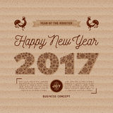 Trendy Happy New Year card 2017 numbers, snowflakes, kraft paper. 2017 numbers lettering of snowflakes, Happy New Year card on kraft paper, Chinese Zodiac Year Royalty Free Stock Images