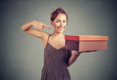 Content young woman presenting box stock photography