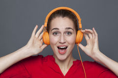 Trendy headphones concept for attractive 20s girl Royalty Free Stock Photo