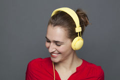 Trendy headphones concept for beautiful 20s girl smiling Royalty Free Stock Image