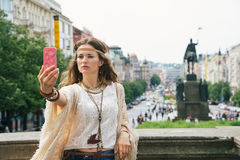 Trendy hippie woman making selfie on Wenceslas Square, Prague Royalty Free Stock Images
