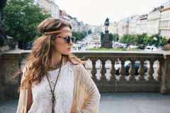 Trendy hippie woman tourist standing on Wenceslas Square, Prague Stock Photo