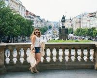 Trendy hippie woman tourist walking on Wenceslas Square, Prague Stock Photo
