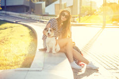 Trendy Hipster Fashion Girl with Dog in the City Royalty Free Stock Images